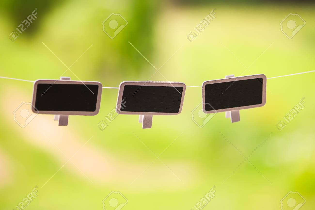 Kleine Schoolbordjes Small Black Framed Chalkboards Hanging Outdoors