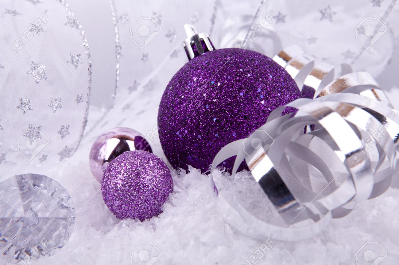 Beautiful christmas decoration in purple and silver on white snow sparkle stock photo 14644546