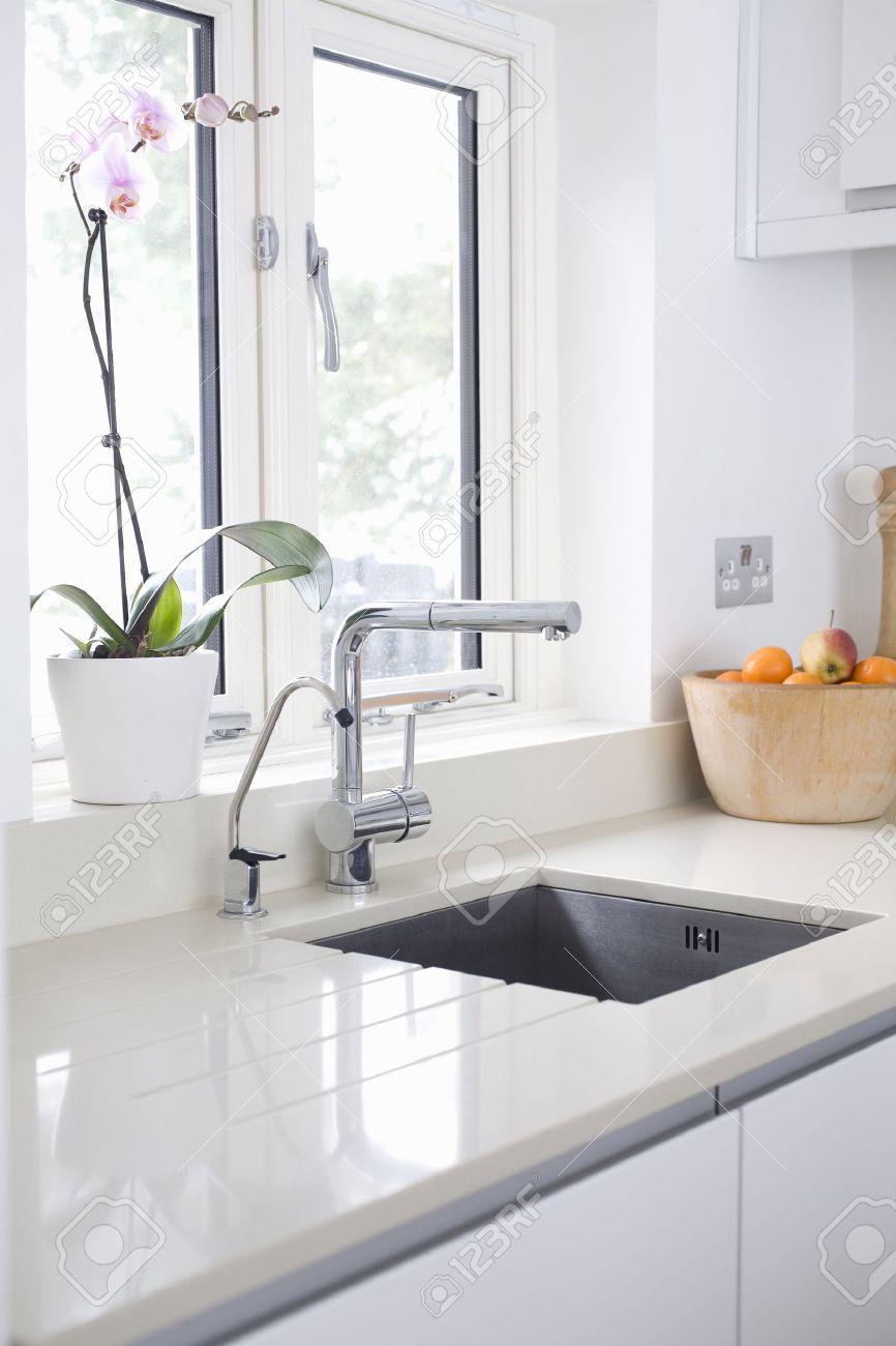 17475177 Modern kitchen sink and tap inset into stone quartz worktop Stock Photo
