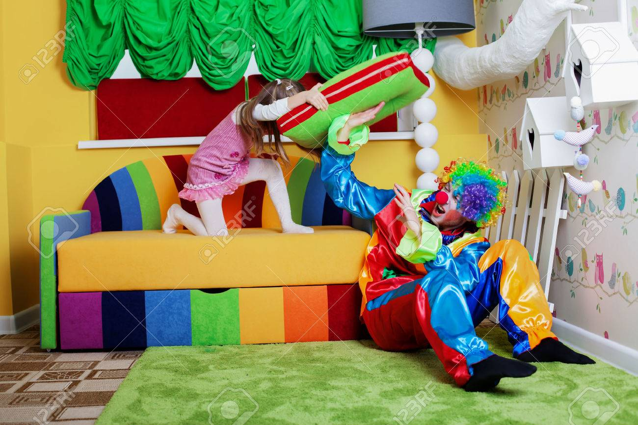 Big Couch Clown Happy Little Girl Beats Clown With A Big Pillow Playroom With