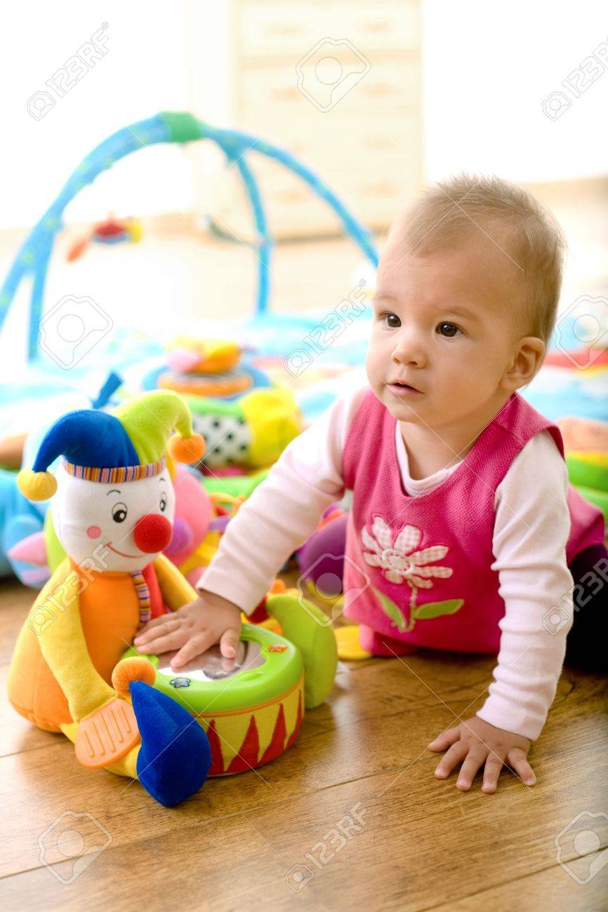 Baby Girl 9 Months Playing With Soft Toys At Home Toys Are Stock Photo Picture And Royalty Free Image Image 5943481