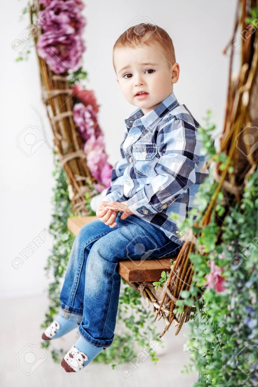 2 Kid Little Boy Sitting On A Swing 1 2 Years The Concept Of Kid