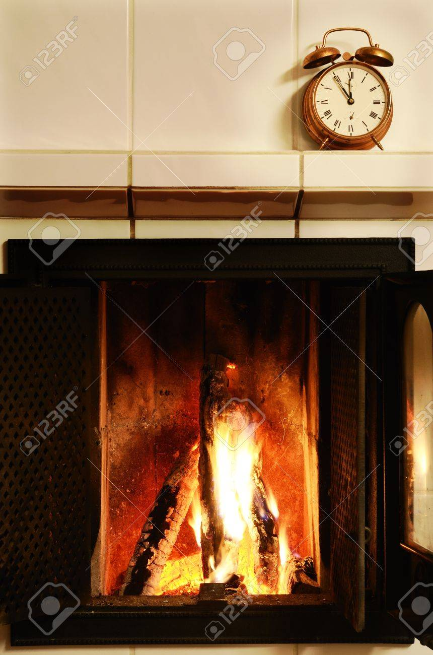 Copper Fireplace Mantel Fireplace Flame And Old Fashioned Copper Alarm Clock On The