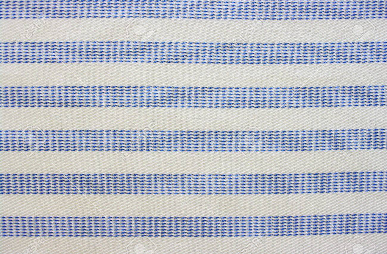 Lit Fabric Close Up Of Blue And White Striped Cotton Fabric Lit From Bottom