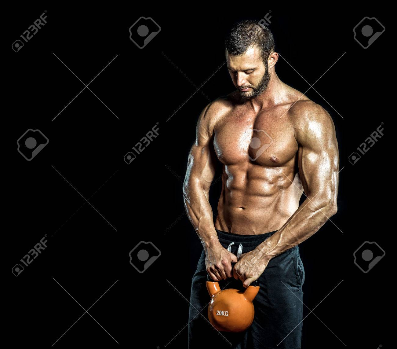 Kettlebell Bodybuilding Handsome Bodybuilder Standing With Kettlebell In Hands Isolated