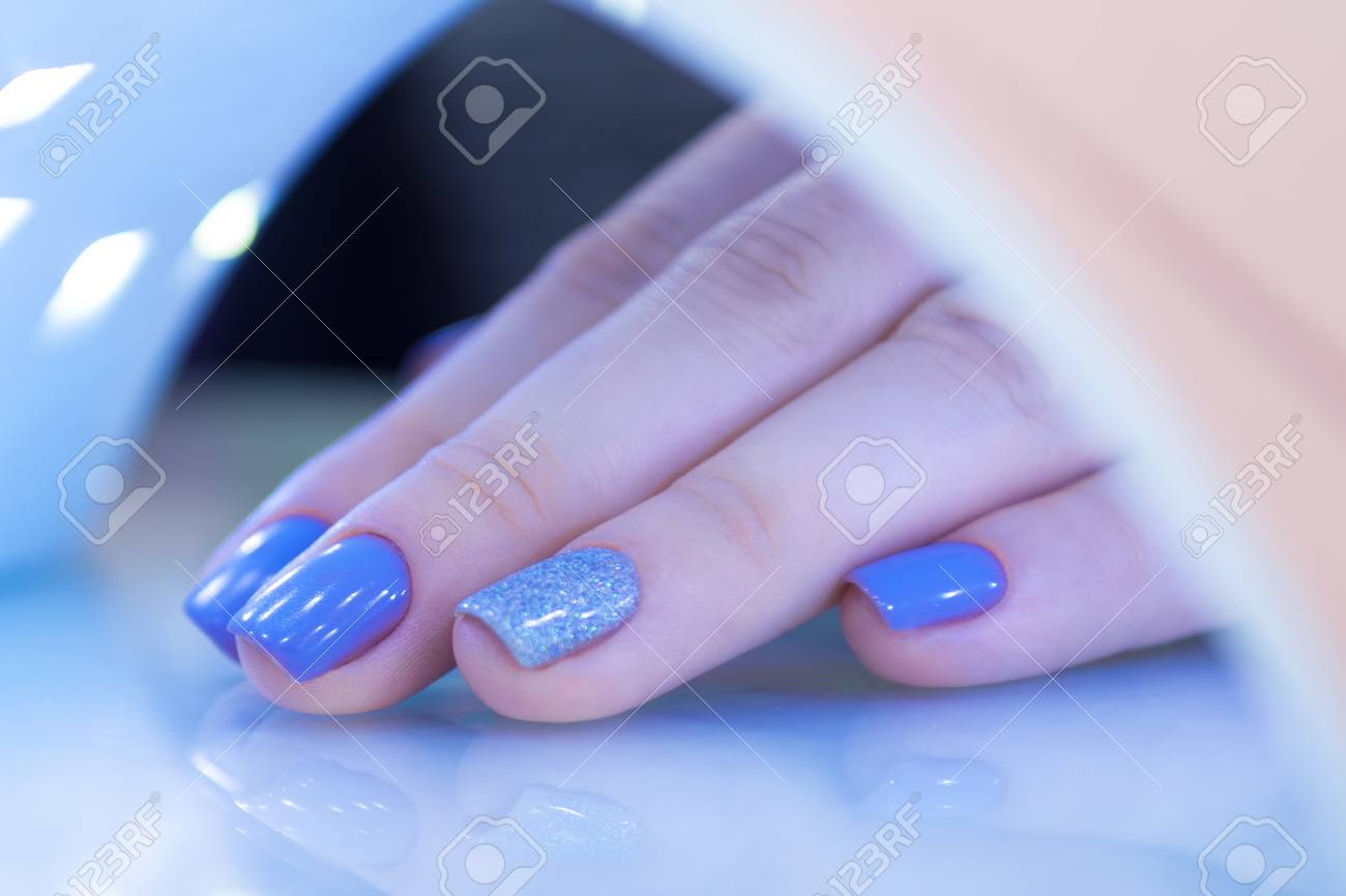 Ultraviolet Lamp Female Hand Close Up Manicure Ultraviolet Lamp For Drying Nail