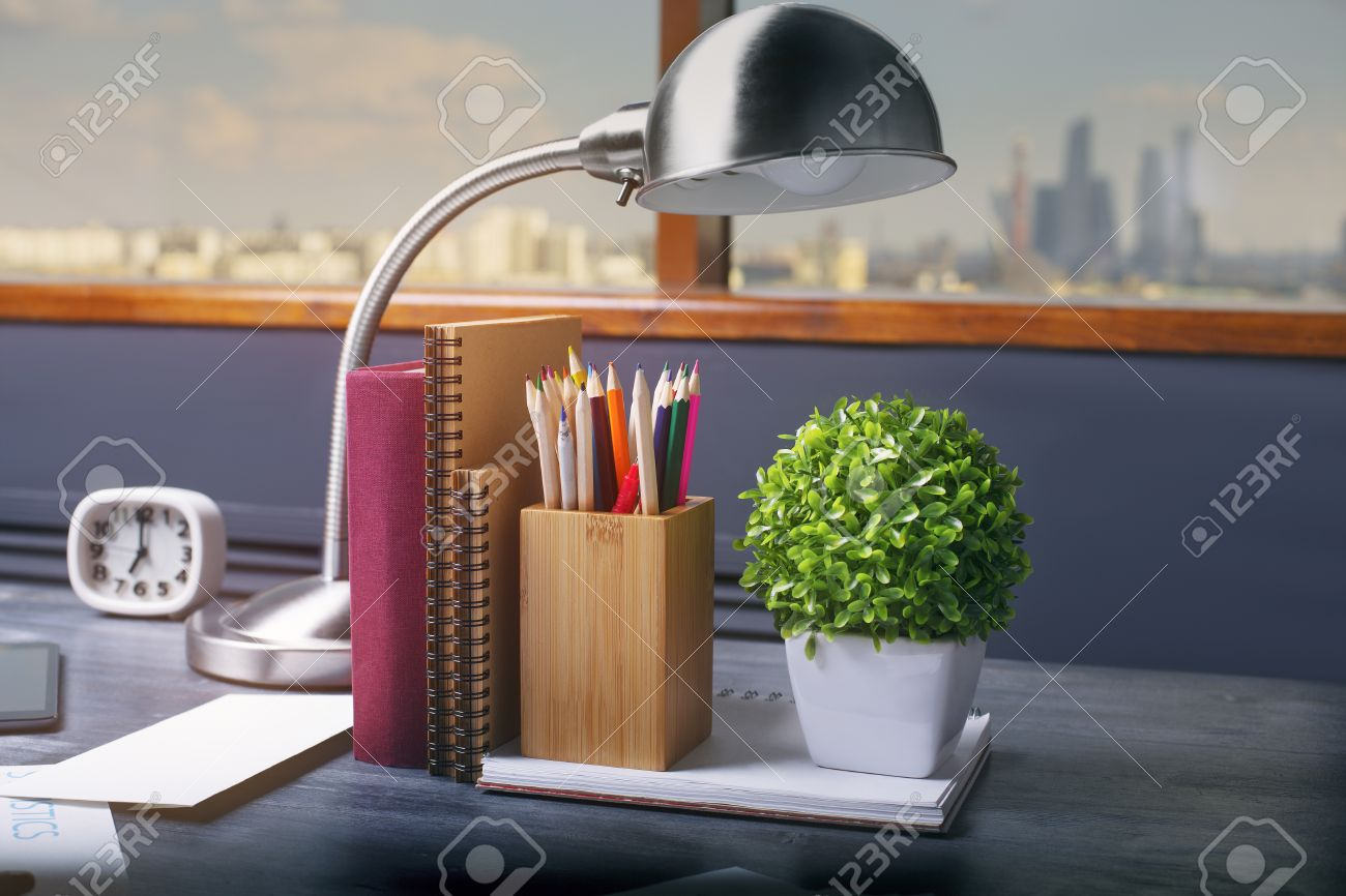 Lamp Plant Closeup Of Table Lamp Notepads Book Pencil Holder Clock And