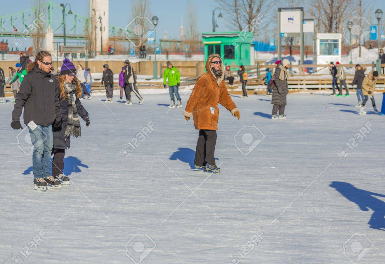 A woman is enjoying ice skating really fast in the skating rink in old port of