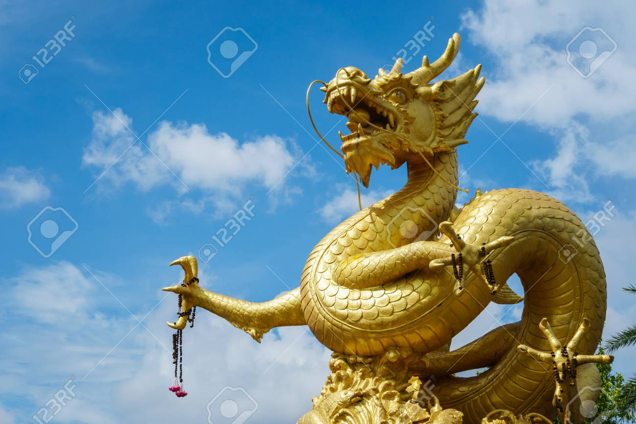 Giant Dragon Statue Giant Golden Chinese Dragon Statue On Blue Sky Background In