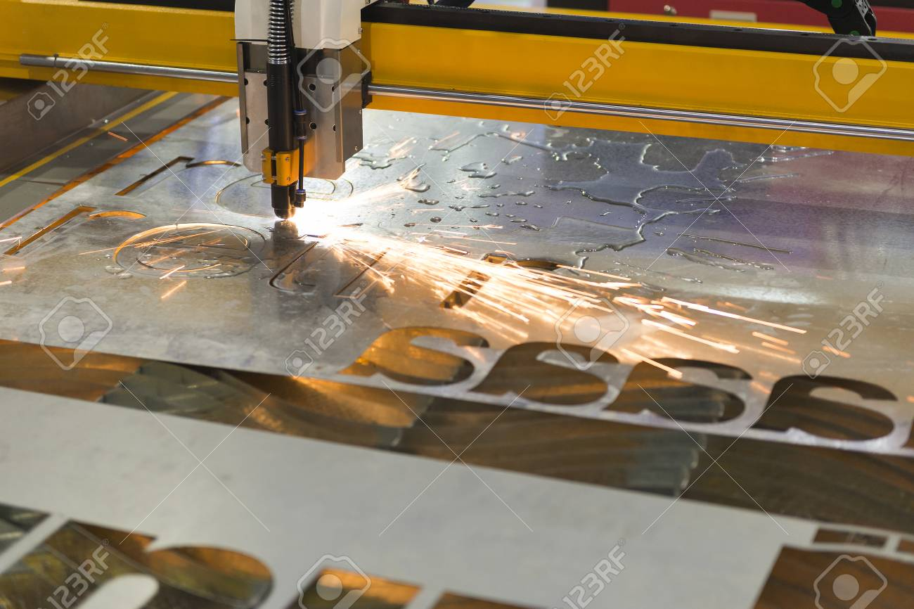 Laser Cutting Machine Metal The Cnc Laser Cut Machine While Cutting The Sheet Metal With