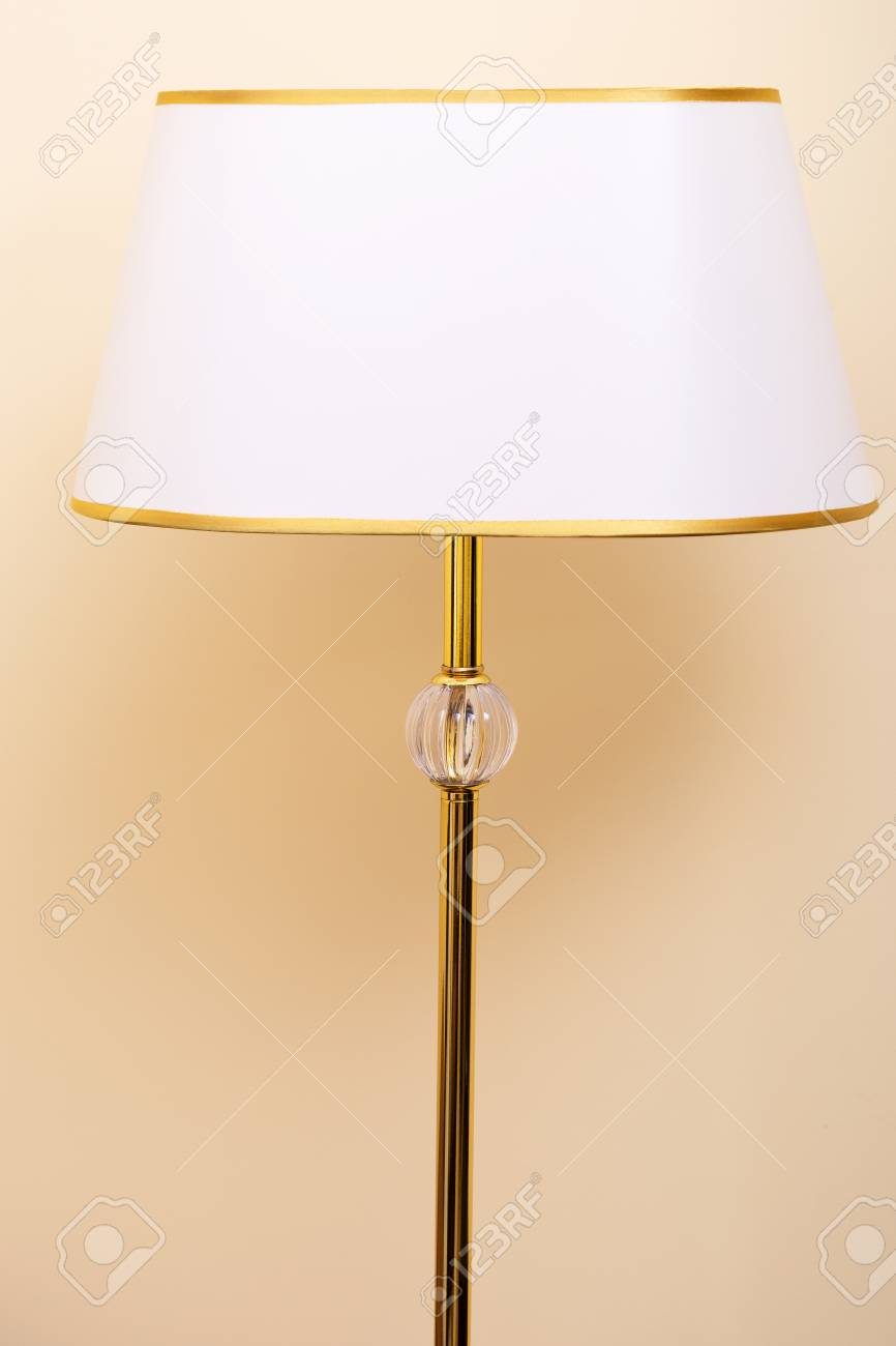 Gold Floor Reading Lamp Floor Lamp On Beige Background Floor Lamp With Gold Fringing