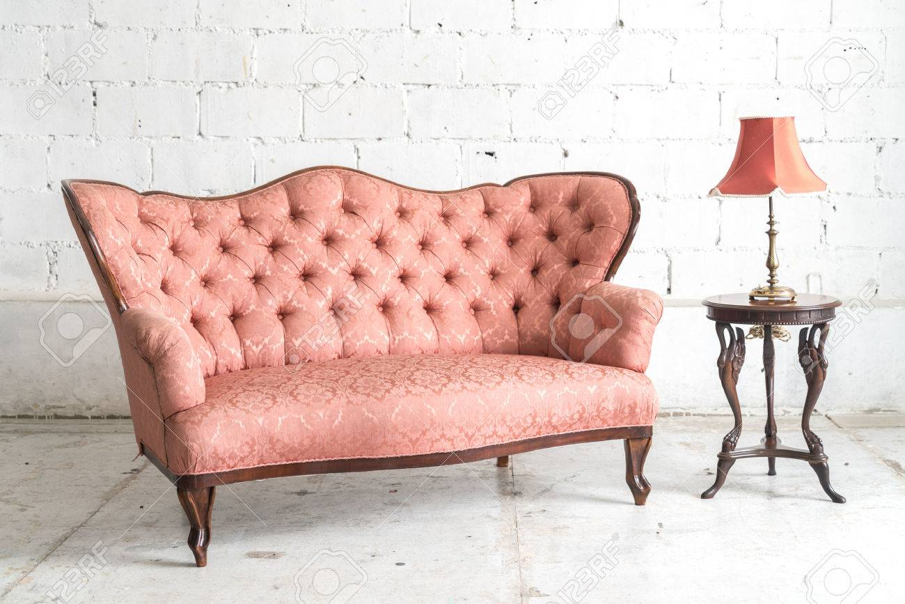 Vintage Couch Pink Vintage Sofa And Lamp On White Wall