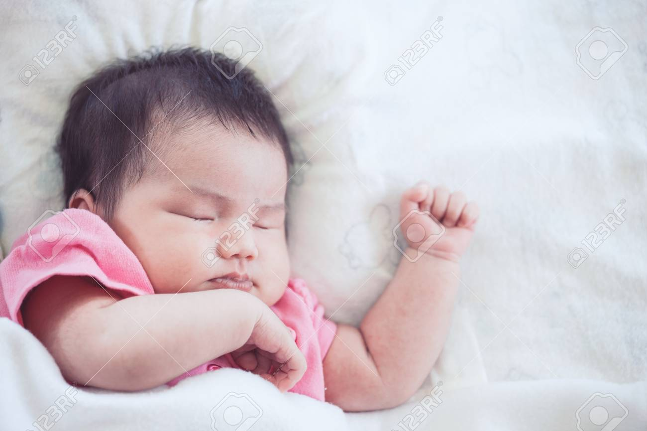 Newborn Sleep Asian Newborn Baby Girl Sleeping On White Bed