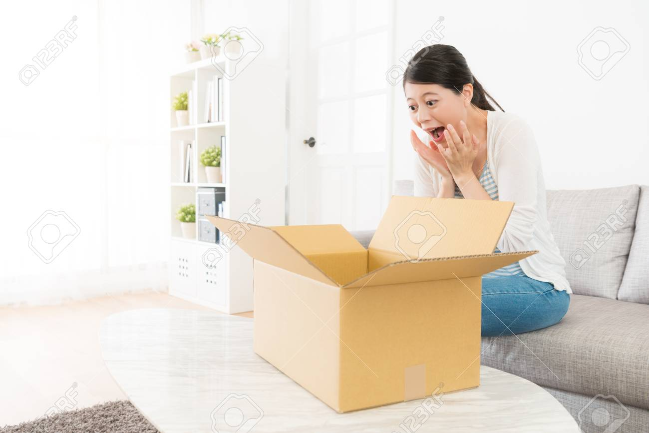 Sofa Open Box Surprised Happy Woman Sitting On Living Room Sofa Open Package