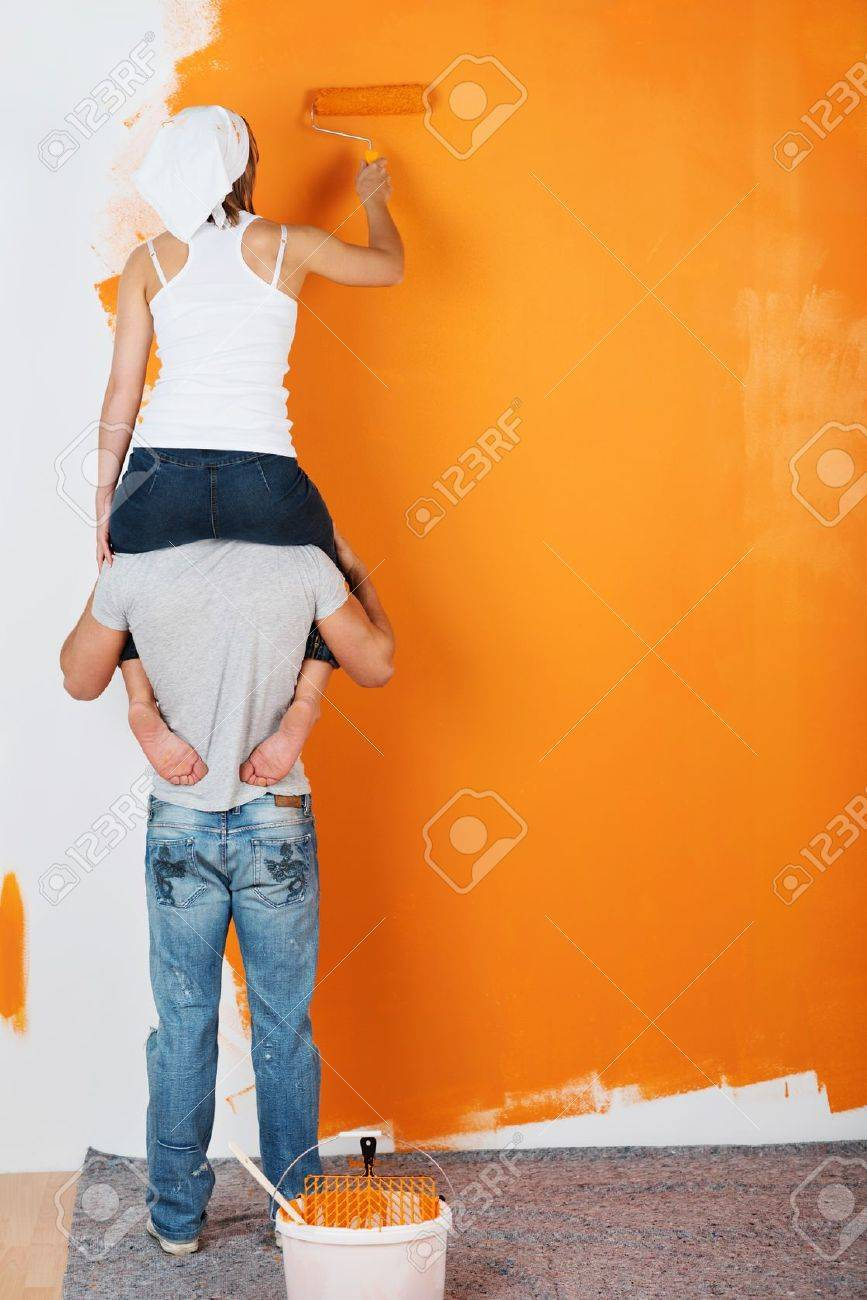 Young Couple Is Having Fun Painting A Wall Stock Photo Picture And Royalty Free Image Image 21162159