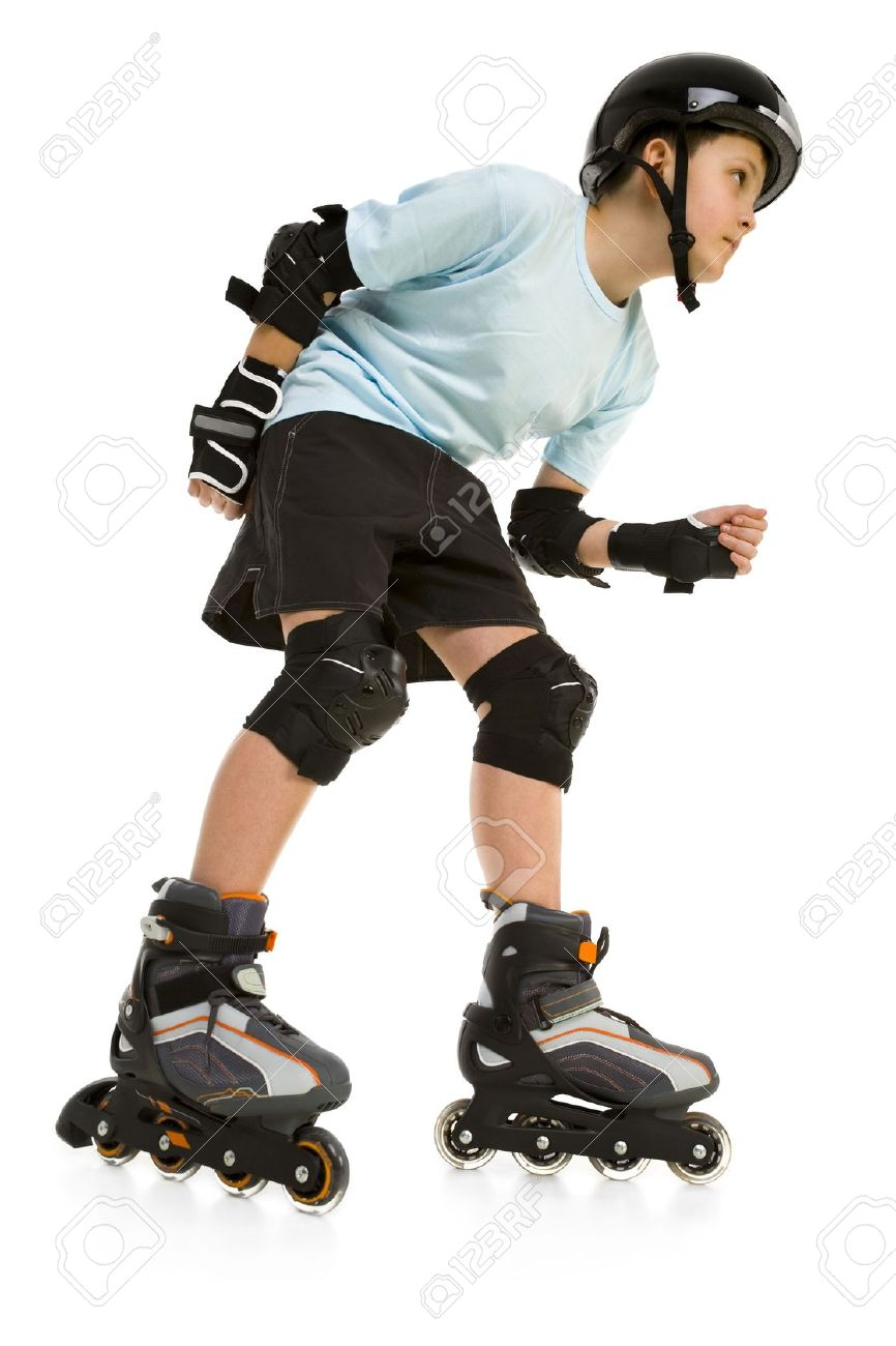 Stock photo young skater boy ready to ride on roller skates he s looking at something side view isolated on white background