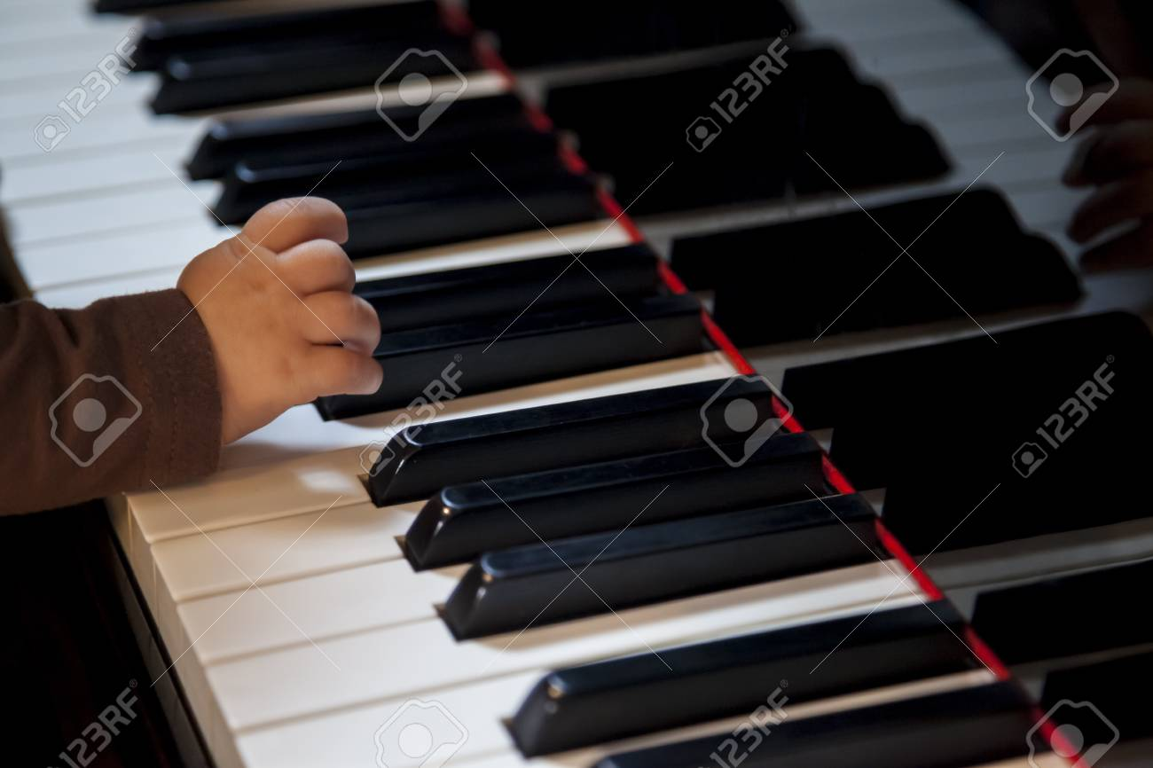How To Play Newborn On Piano Newborn Kid Hand Trying To Play Classic Piano