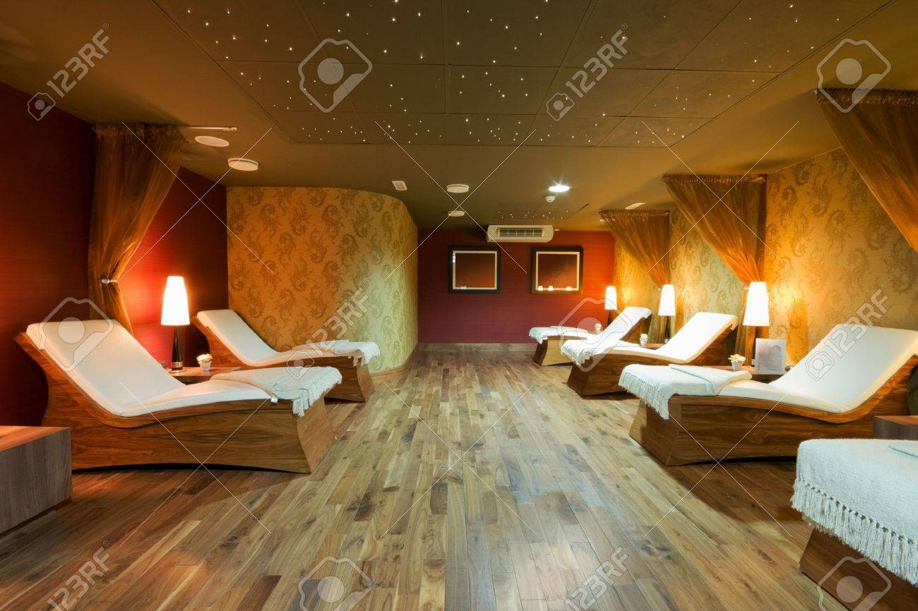 Wooden Beds Spa Restroom Interior And Row Of Wooden Beds With White Towels