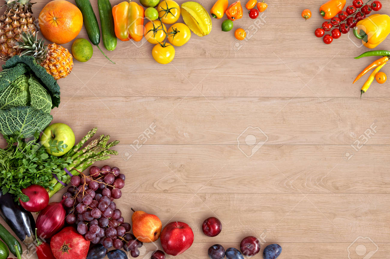 Healthy eating background studio photography of different fruits and vegetables on wooden table stock photo