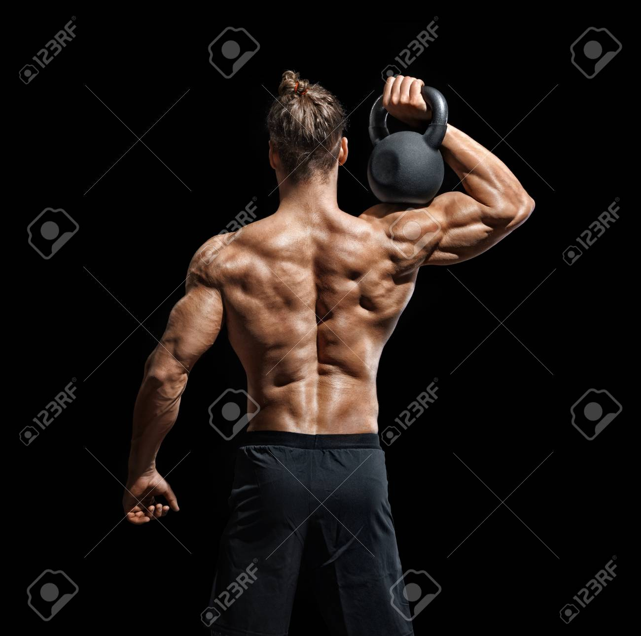 Kettlebell Bodybuilding Young Bodybuilder Doing Exercise With Kettlebell Rear View Of