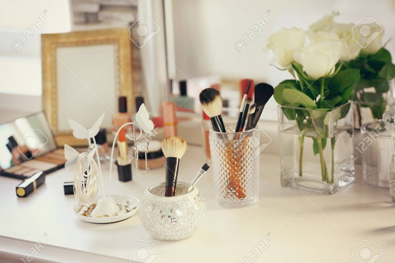Cosmetic Table Cosmetic Brushes With Jewelry Holder On Light Dressing Table