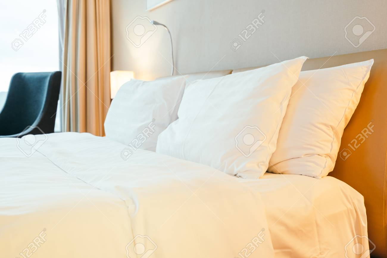 White Decoration Bedroom White Pillow On Bed Decoration In Hotel Bedroom Interior