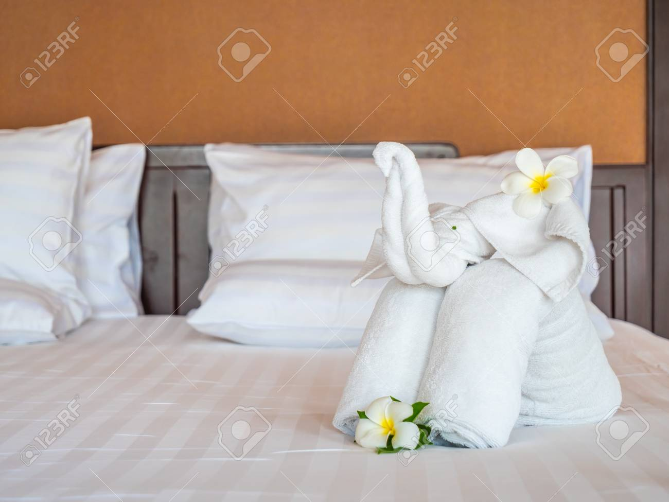 Decoration Hotel White Elephant Towel And Comfortable Pillow On Bed Decoration