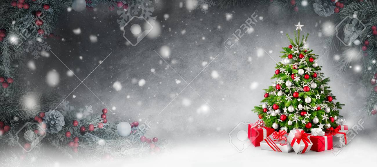 Gorgeous Elegant Christmas Tree With Gifts In Red And Silver Stock