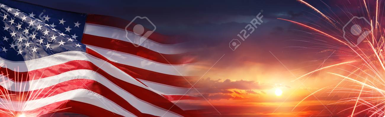 American Celebration - Usa Flag And Fireworks At Sunset Stock Photo