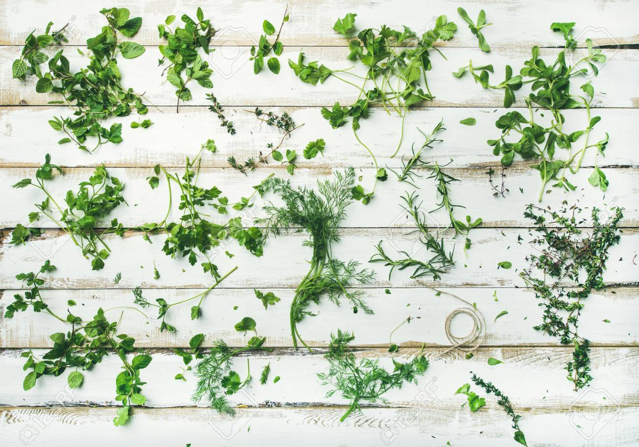 Herbal Wallpaper Flat Lay Pattern Of Bunches Of Fresh Green Herbs Parsley Mint
