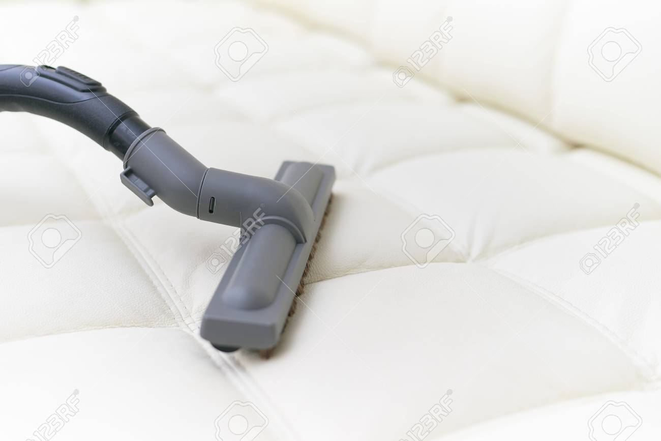 Sofa Vacuum Cleaner Brush The Vacuum Cleaner Brush Is On The Leather Sofa White Leather Sofa