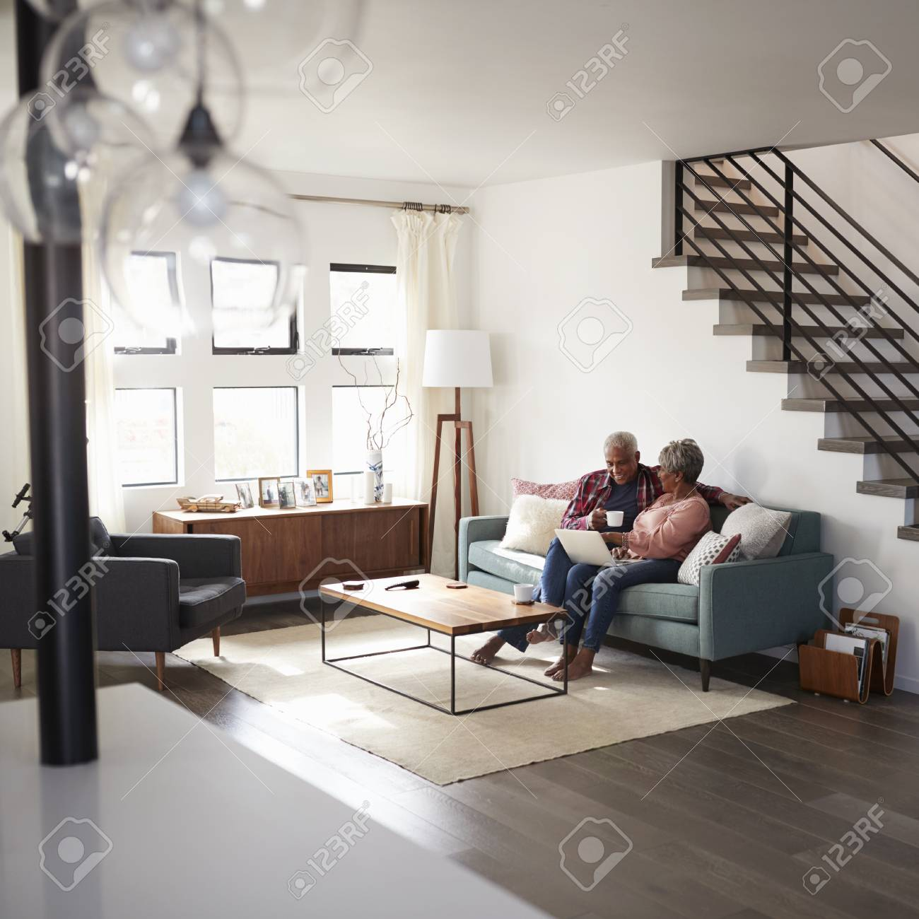 Sofa Online Shop Senior Couple Sitting On Sofa At Home Using Laptop To Shop Online