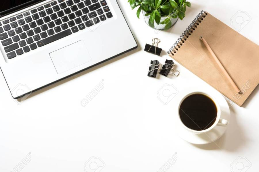 Office workplace with laptop, cup of coffee,sketch-book, accessories on white
