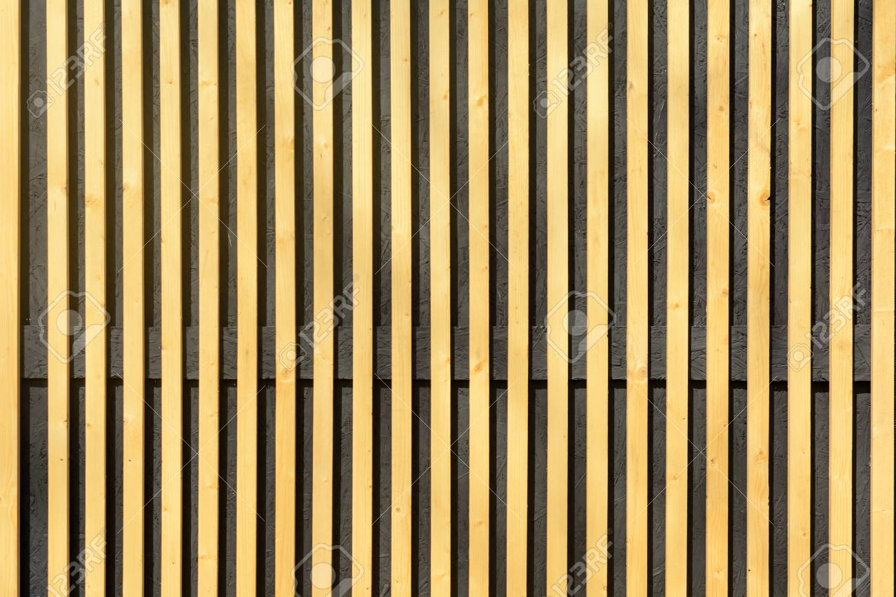Vertical Wood Slat Wall Wall Of Thin Wooden Slats Vertical Parallel Plates