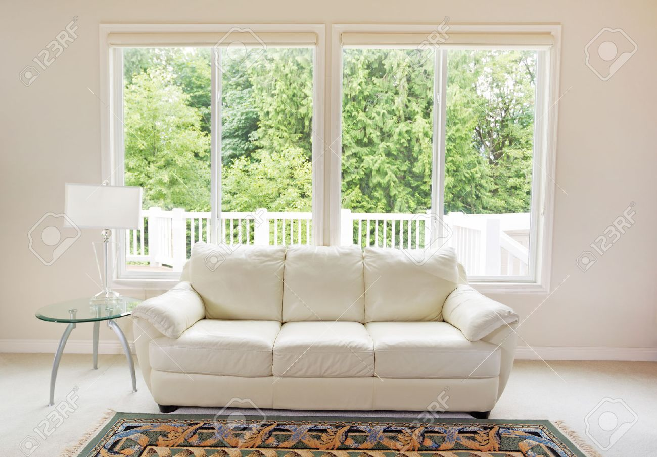 White Leather Couch Clean Family Room With White Leather Couch And Large Windows