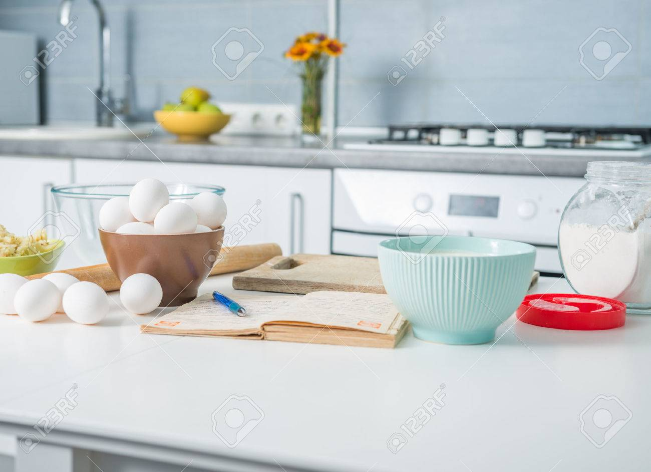 43785616 ingredients for baking and recioe book on a kitchen table Stock Photo