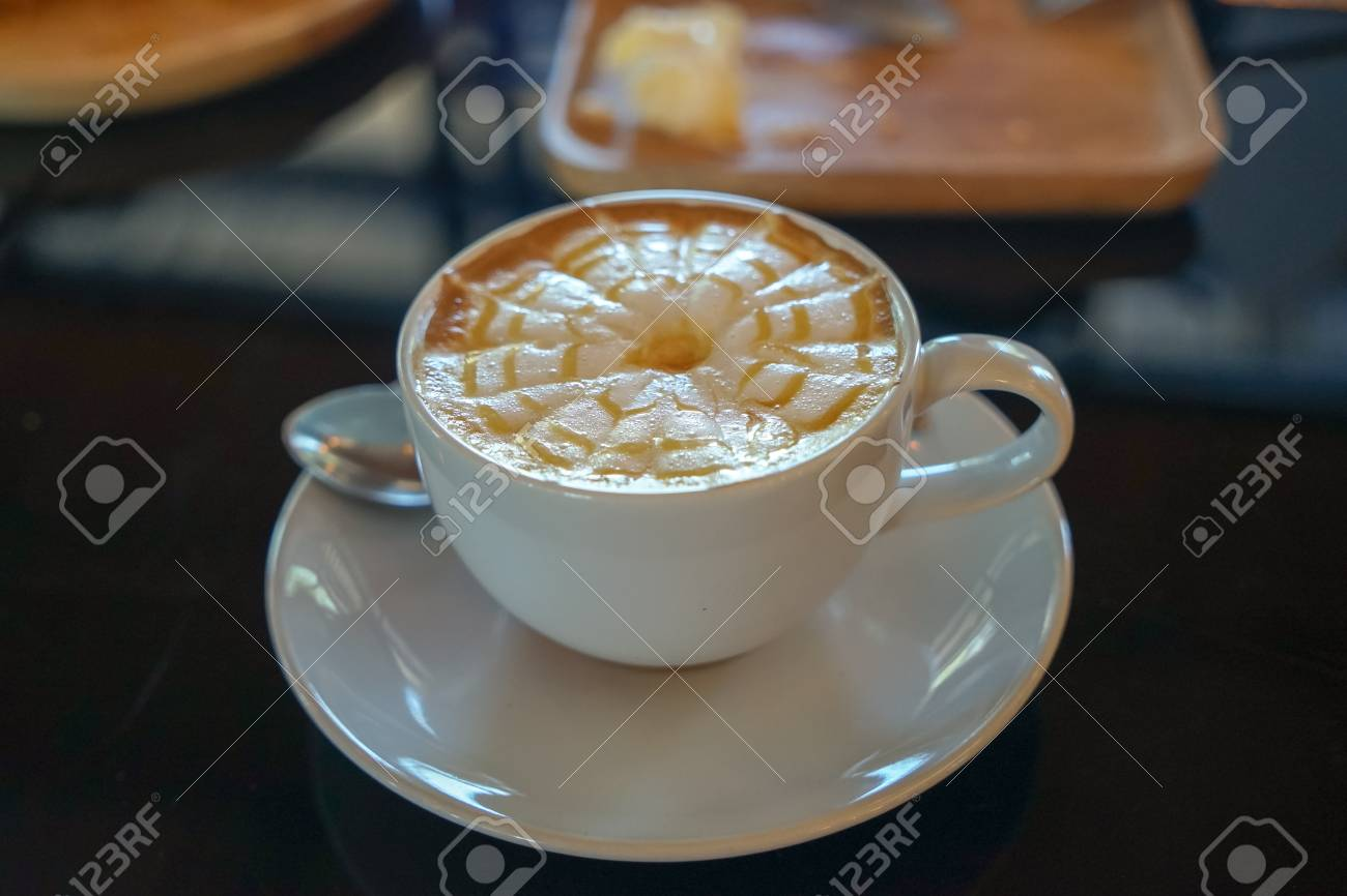 Caffe Latte Caffe Latte With Latte Art Design In Spider Web Flower Pattern