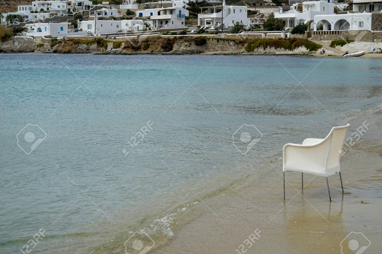 Bank Rattan Scene Of Empty Chair In White Rattan Sitting On Sand Beach With