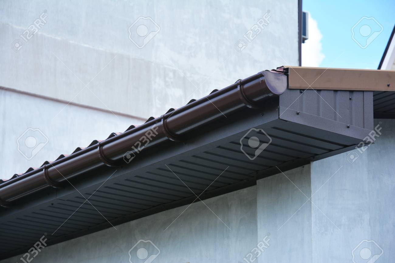 Fascia Board Close Up On House Plastic Roof Gutter With Soffit And Fascia