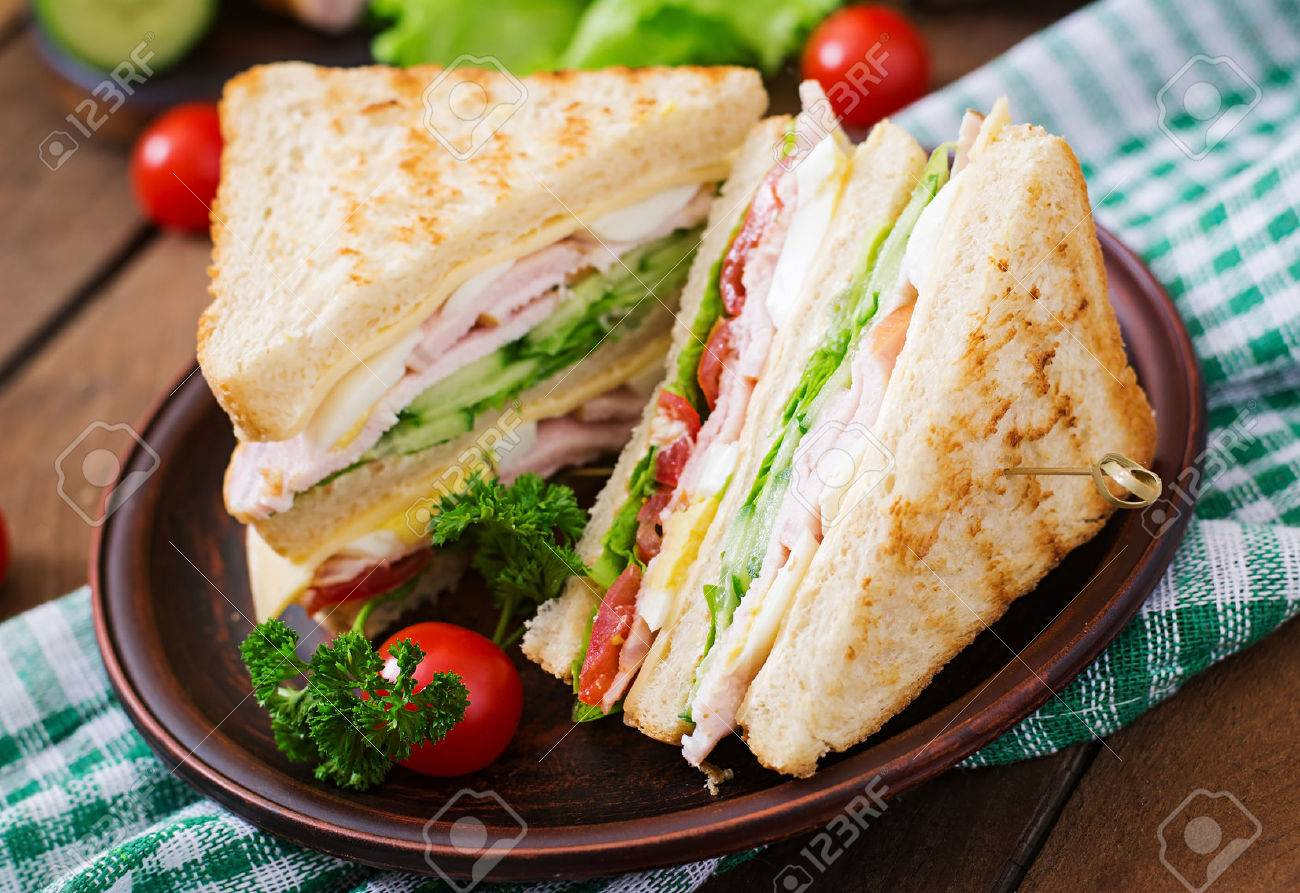 Club Sandwich With Cheese Cucumber Tomato Ham And Eggs Stock Photo Picture And Royalty Free Image Image 52913648