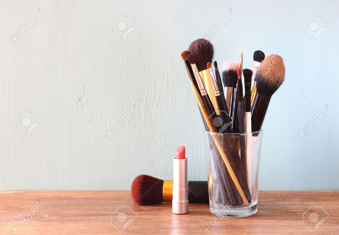 Wooden Make Up Table Make Up Brushes Over Wooden Table