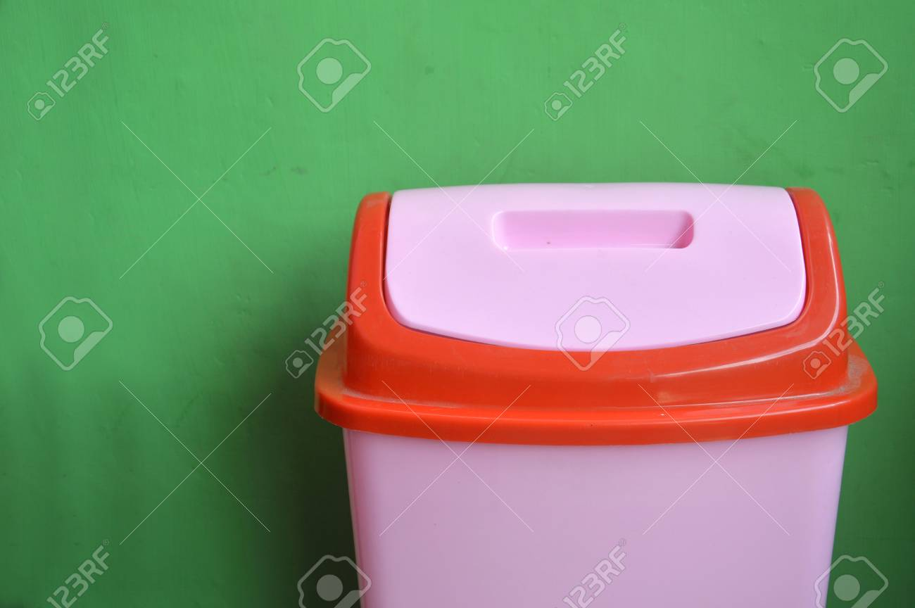 Pink Bins Pink Plastic Bins On The Green Wall