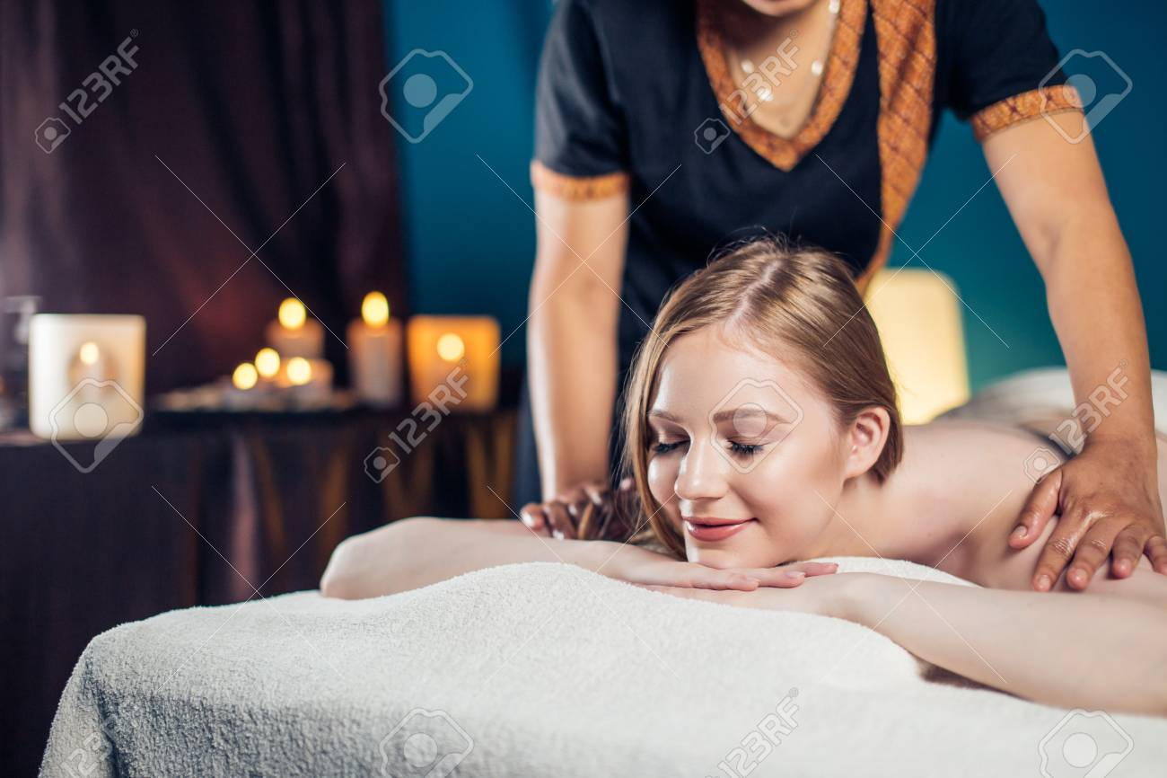 Where Can I Get Full Body Massage Young Peaceful Blonde Woman Enjoying Full Body Massage At Spa