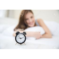 Small Crop Of Looking At Clock