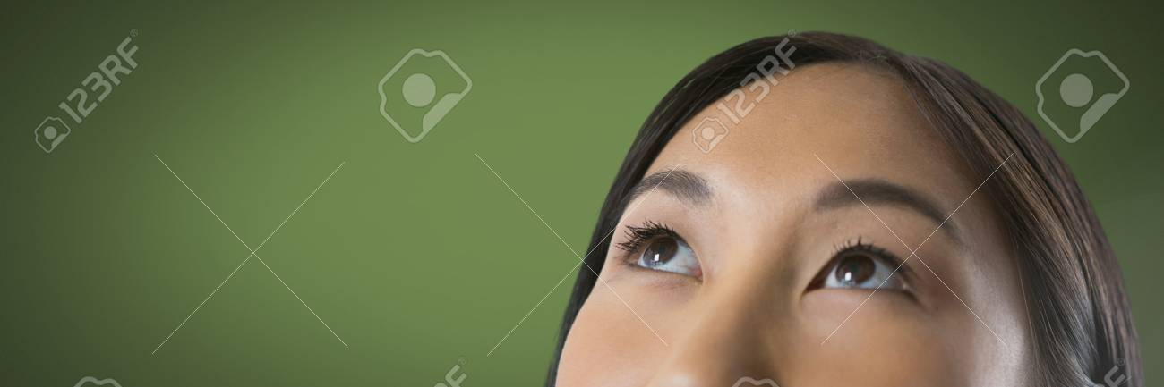 Digital Composite Of Woman Looking Up With Green Background Stock