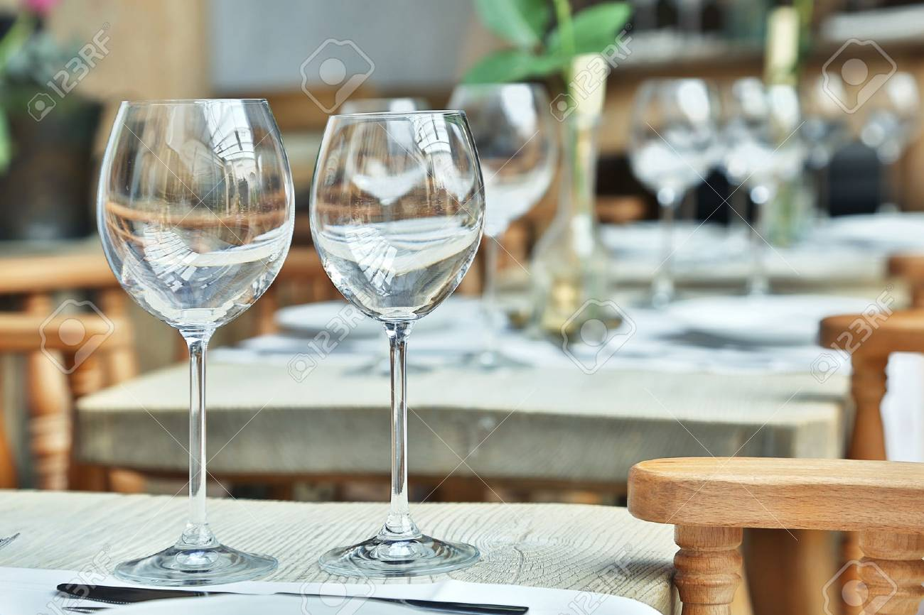 Vintage Café Table Setting With Wine Glasses At The Vintage Cafe