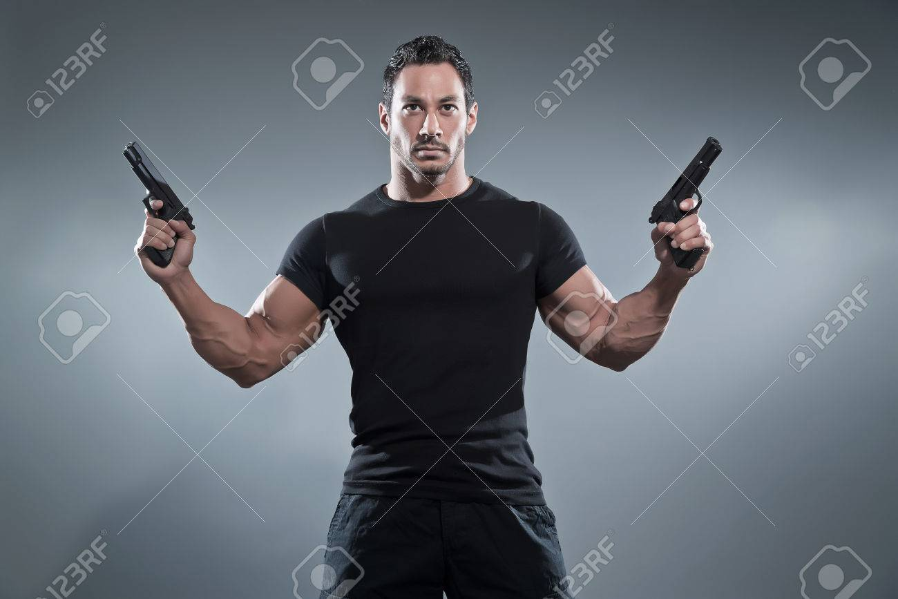 Black t shirt grey pants - Black T Shirt Grey Pants Action Hero Muscled Man Holding Two Guns Wearing Black T Download