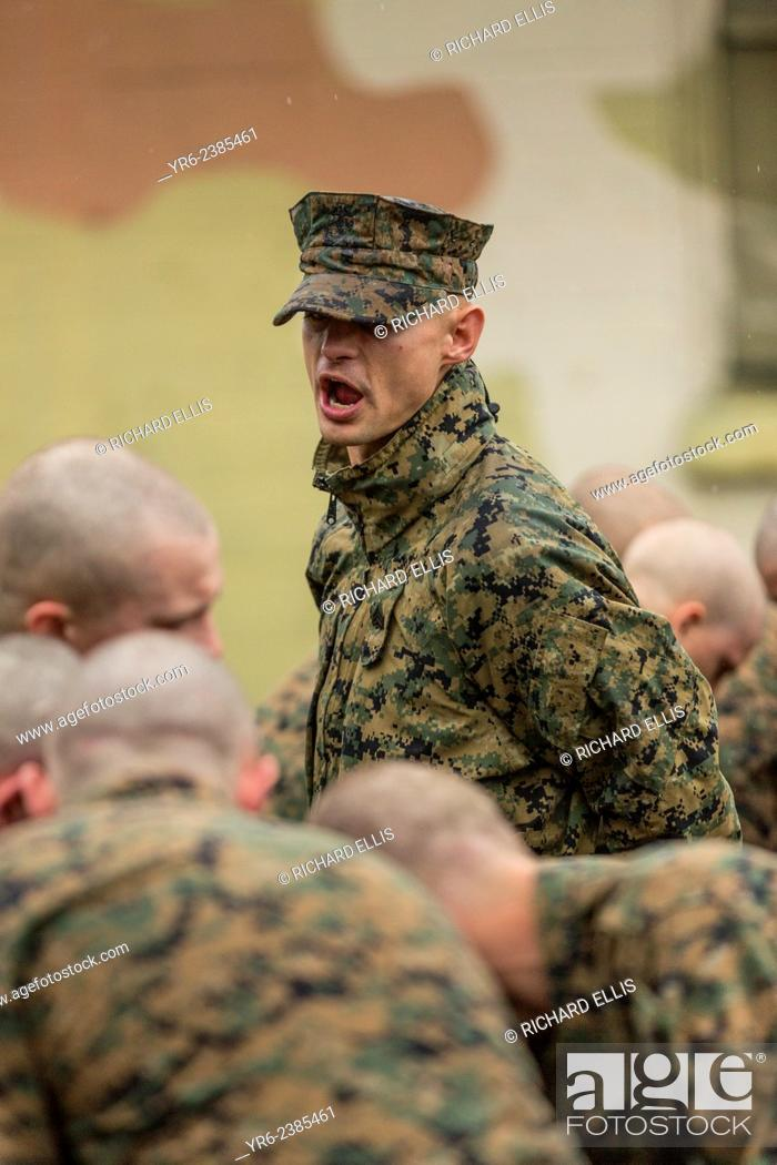 US Marine Corps drill instructor shouts instructions to recruits