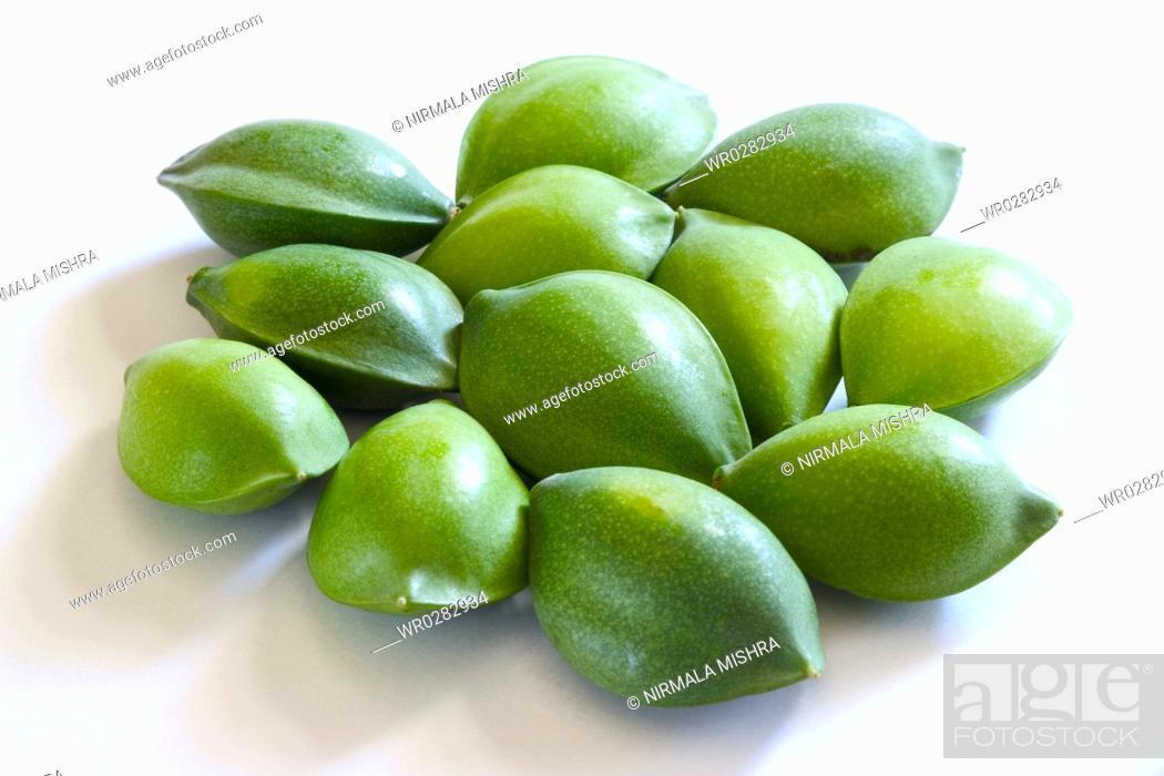 Fruit , one dozen green eye shaped almond badam Prunus dulcis on