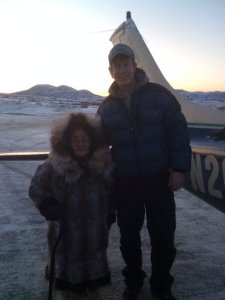 Trent with a 98 yr old woman in Western Alaska, who made him a fur hat from beaver and seal.